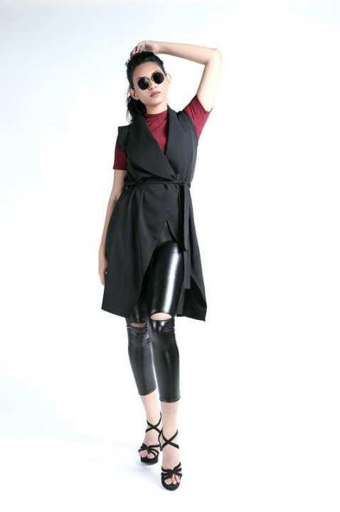 Black sleeveless over coat